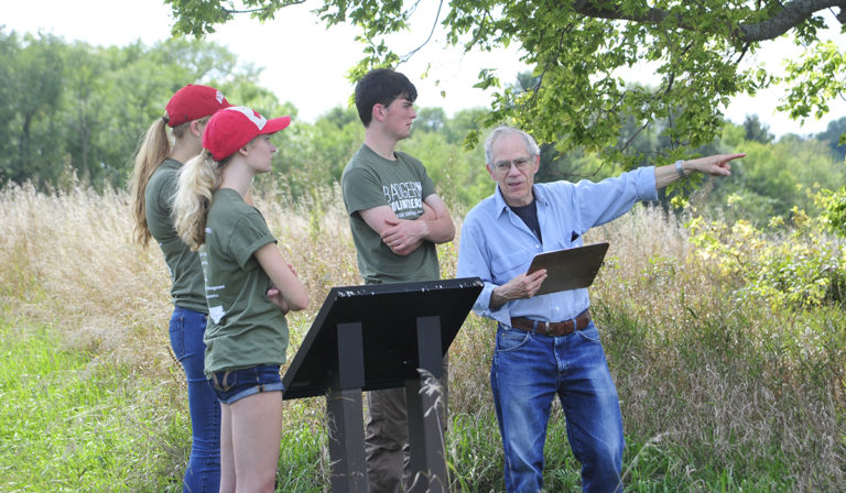 Badger Volunteers receive direction from a community partner