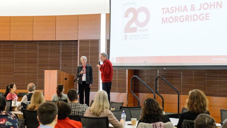 Tasha and John Morgridge address a gathering