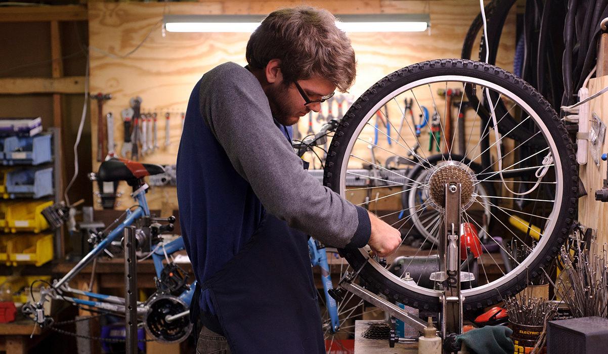 Badger Volunteer fixing a bike