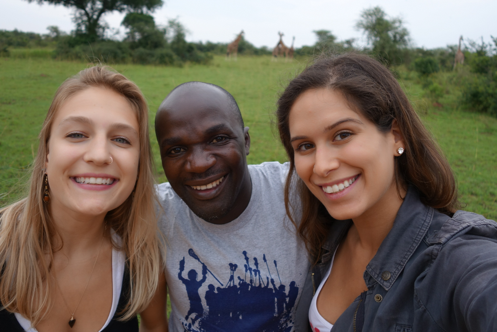 Jackie Laitsch (left) and Helena Record (right) with Ronald Nsimbe, one of the project's collaborators in Uganda.