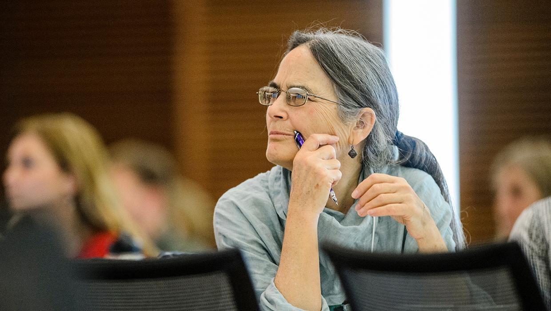 Woman listening to presentation