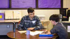 Achievement Connections math tutor works with high school student