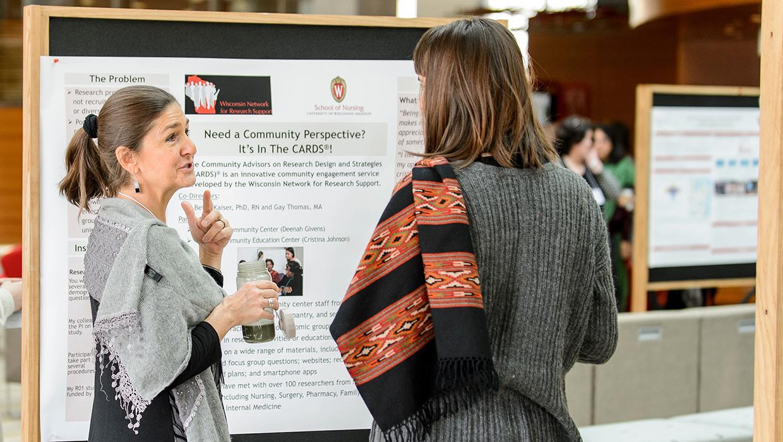 Presenters discuss research