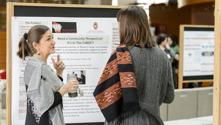 Presenters discuss details of their projects at a gathering of educators, students, national experts and community leaders during a Campus and Community Summit