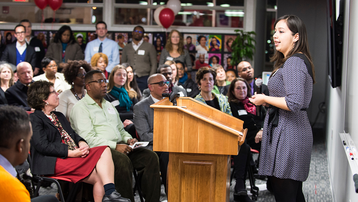 Julissa Ventura makes opening remarks during an open house for the UW South Madison Partnership