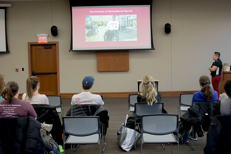 Coordinator of Competitive Sports Tori Landron shows UW-Madison students a video on Badgers ADAPT.