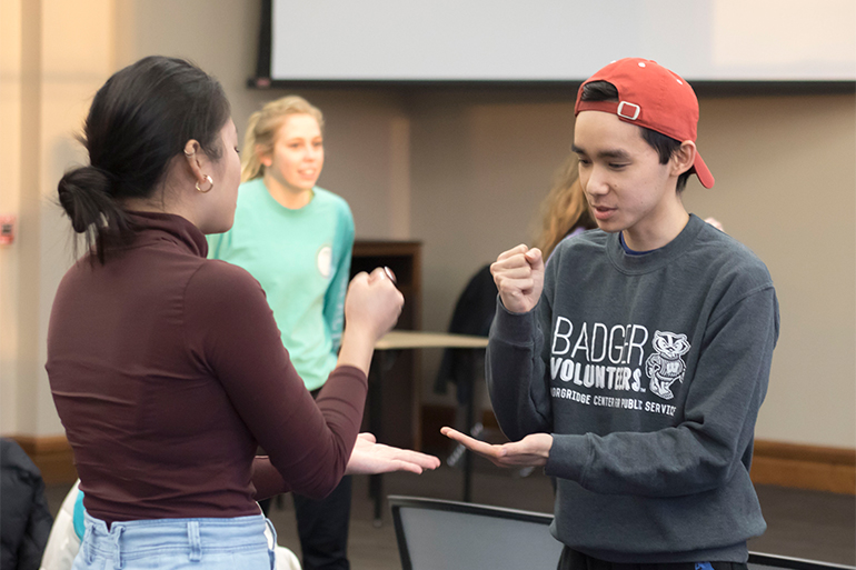 Students engage in Rock-Paper-Scissors as the event's first activity.