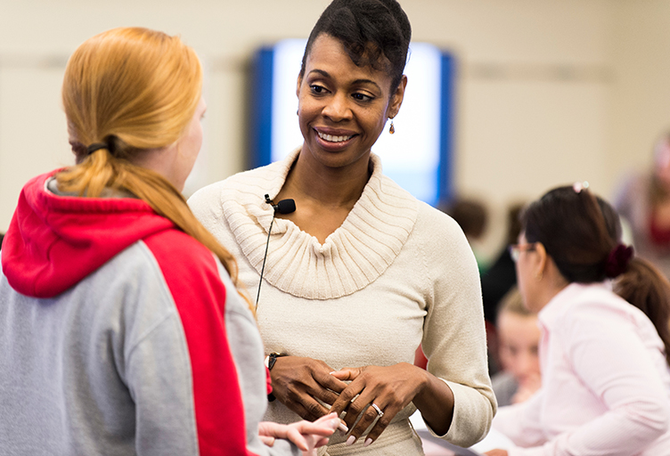 Associate Professor Earlise Ward, right, talks with a student during a break co-teaching a section of N310: Mental Health and Mental Illness, a School of Nursing class taught in the Active Learning Classroom (ALC) in Signe Skott Cooper Hall at the University of Wisconsin-Madison on Oct. 22, 2014. The interactive classroom features clustered seating and state-of-the-art computing and audio-visual technology as tools for student engagement. (Photo by Jeff Miller/UW-Madison)