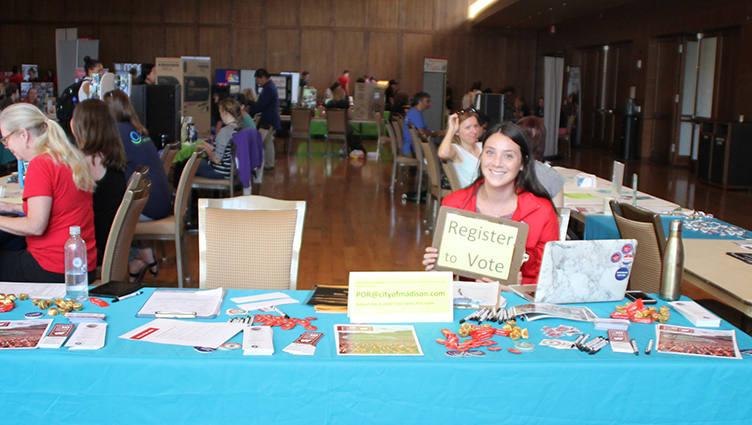 Emily Hutchins registers voters at this year's Public Service Fair.