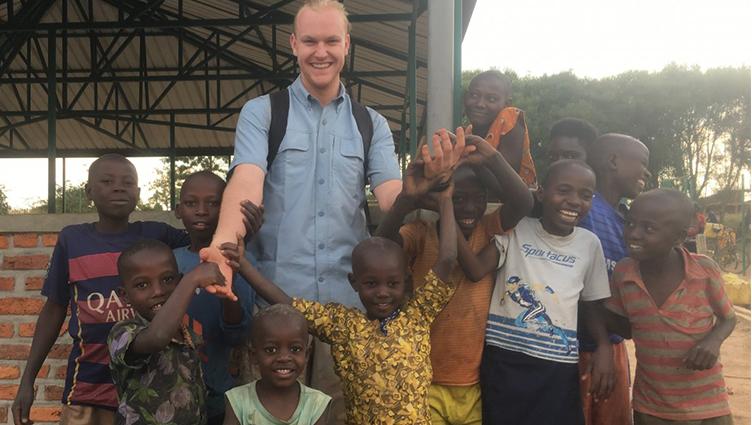 Olson_in_rwanda_with_kids