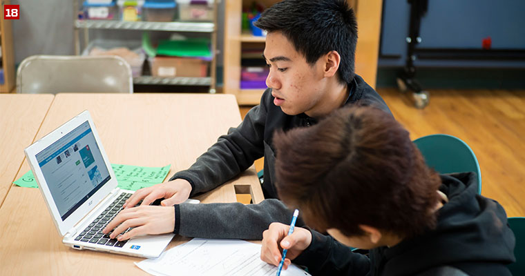 Badger Volunteer Kenneth Mui tutors a student in math at the Bayview Foundation, a nonprofit organization that provides affordable housing and supportive services to approximately 300 low-income residents, primarily immigrants and refugees.