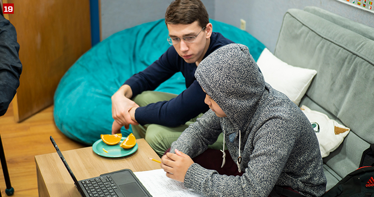 Badger Volunteer Mark Salamone tutors a student in history at the Bayview Foundation, a nonprofit organization that provides affordable housing and supportive services to approximately 300 low-income residents, primarily immigrants and refugees.
