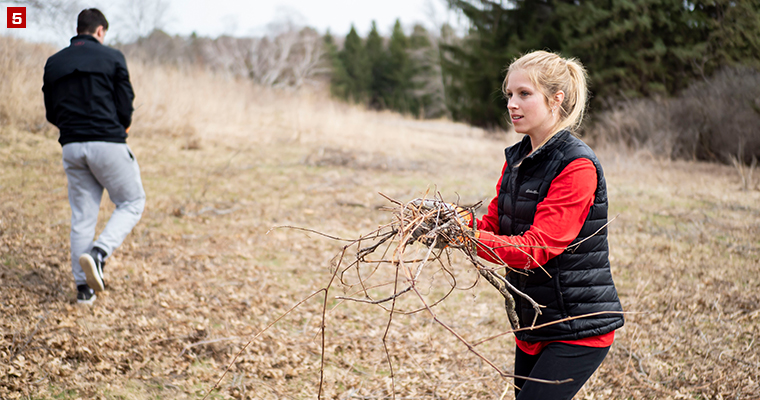 Badger Volunteer Ashlyn Barry helps pick up broken branches at the Holy Wisdom Monastery, a community that offers hospitality to individuals and groups throughpeaceful, contemplative spaces, healthy meals and interaction with other people.