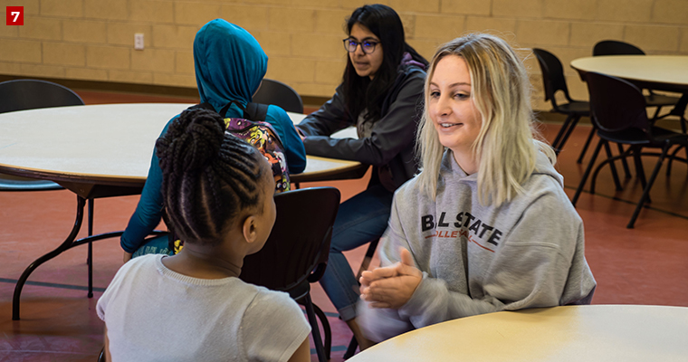 Badger Volunteer Amalia Jaeck plays with a student before lunchtime at the Lussier Community Education Center, a facility that builds community, creates opportunities and enriches education.