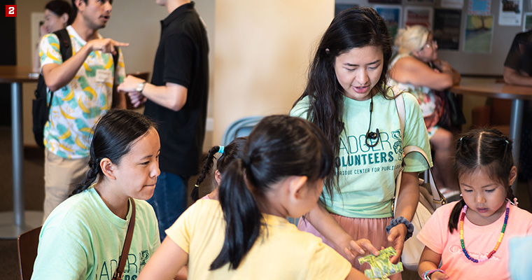 Badger Volunteer Grace Hawkins (left) and Nan Nonguang (right) piecing together a puzzle with kids from Madison International Partnerships, an organization that strives to make their community more welcoming to international residents.