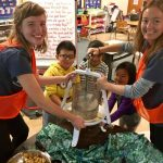 McBride's Badger Volunteers Team at Lakeview Elementary School's environmental education program making homemade apple cider with the students.