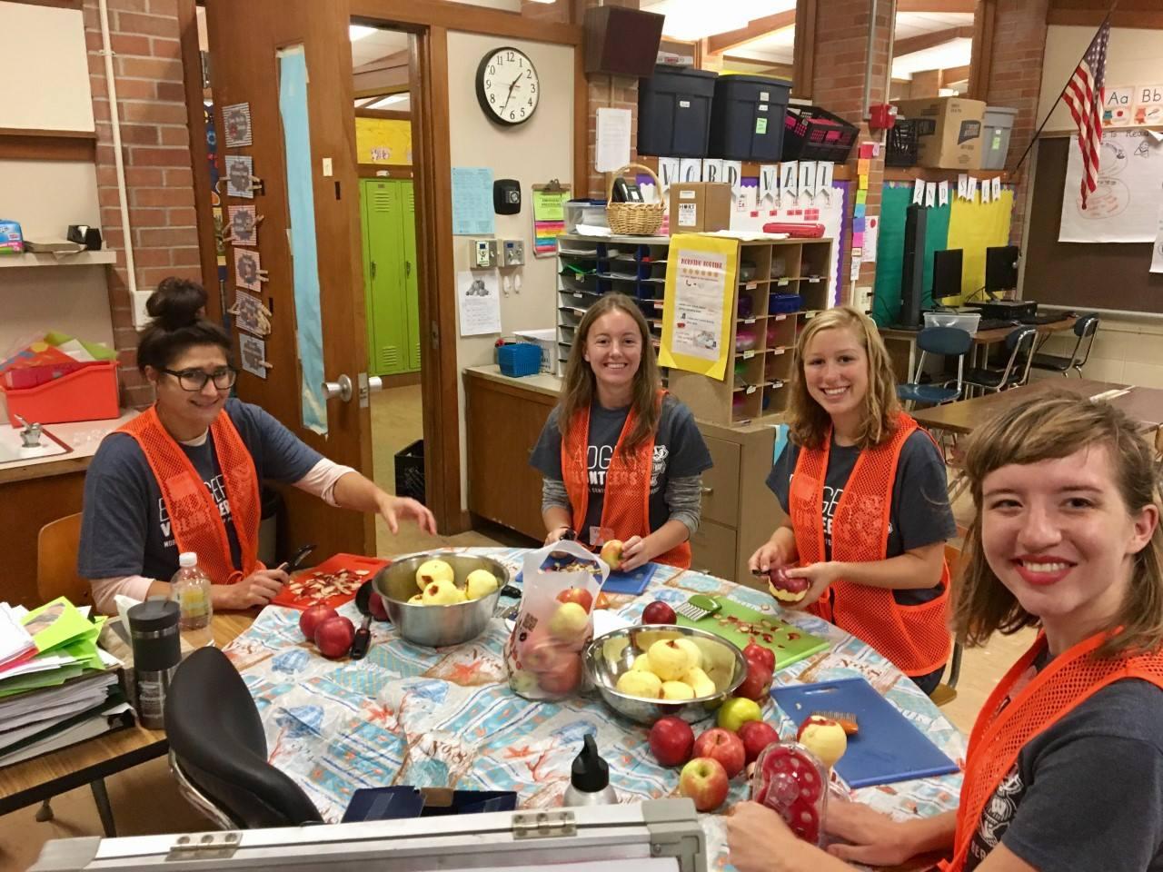 Gillian McBride (far right) at Lakeview Elementary as a Badger Volunteer Team Leader.
