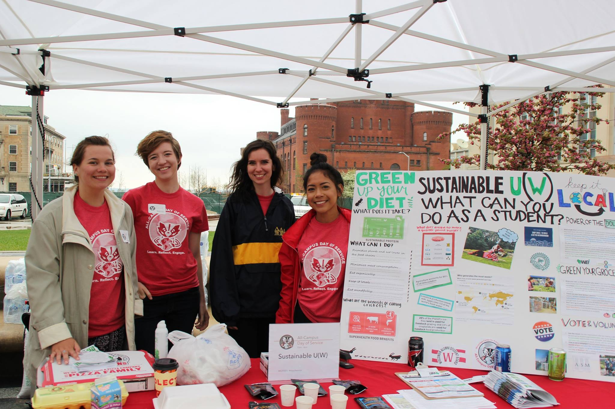 McBride at the 2017 All-Campus Day of Service, when she and fellow intern Junalee Ly (far right) organized a sustainability-themed booth.